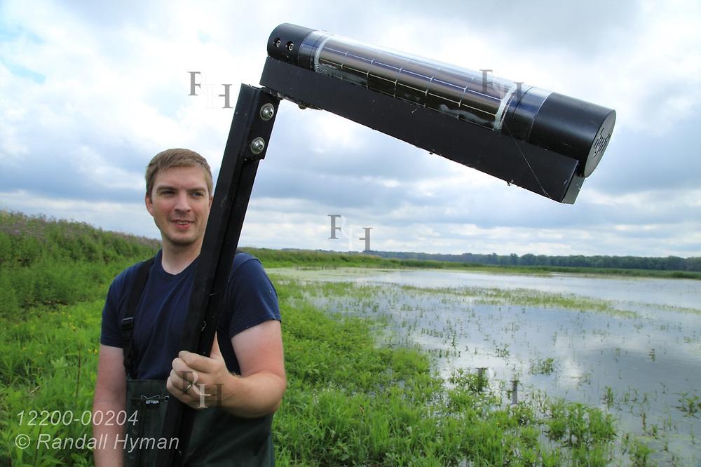 Hyfi field tech Matt Craddock gets ready to install water-level sensor in wetland at Shiawassee National Wildlife Refuge; Saginaw, Michigan.