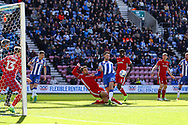 Nick Powell of Wigan Athletic looks to shoot but is tackled by Rickie Lambert of Cardiff City. EFL Skybet Championship match , Wigan Athletic v Cardiff city at the DW Stadium in Wigan, Lancs on Saturday 22nd April 2017.<br /> pic by Chris Stading, Andrew Orchard sports photography.