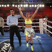 Nydia Feliciano reacts as the judges announce her the winner over  Noemi Bosques during a Telemundo Boxeo boxing match at the A La Carte Pavilion on Friday,  March 13, 2015 in Tampa, Florida.  Feliciano won the bout by split decision. (AP Photo/Alex Menendez)
