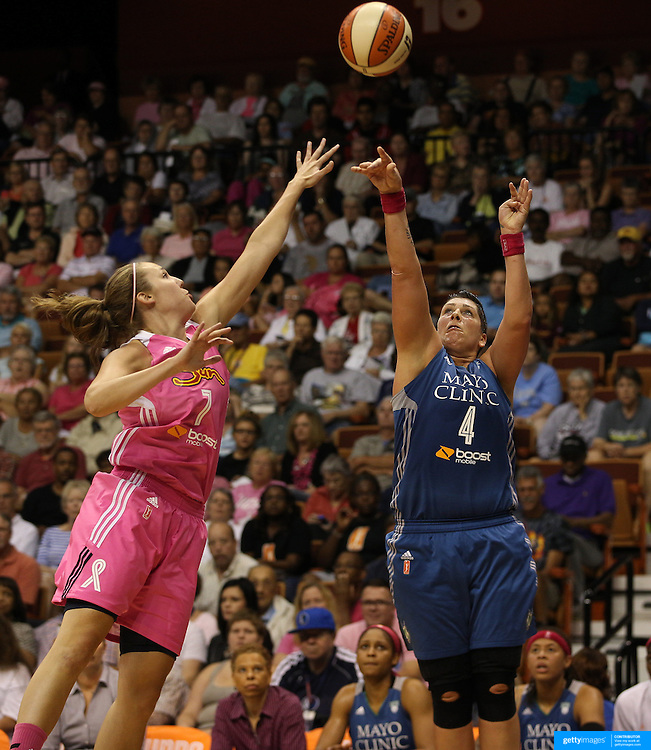 Janel McCarville, (right), Minnesota Lynx, shoots over Kayla Pedersen, Connecticut Sun, during the Connecticut Sun Vs Minnesota Lynx, WNBA regular season game at Mohegan Sun Arena, Uncasville, Connecticut, USA. 27th July 2014. Photo Tim Clayton