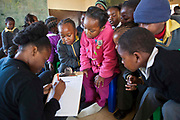 "Kitty, one of the AREPP: Theatre for Life actors evaluates the show 'No Monkey Business' with the pupils of Matsie Steyn primary school, Sharpeville, Vereeniging, South Africa. 'No Monkey Business"" is an AREPP: Theatre for Life production providing interactive social life skills education to schoolchildren through theatre productions. They are based in Johannesburg, South Africa and are on tour for 3 months doing performances everyday at schools across the country."