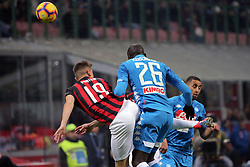January 26, 2019 - Milan, Milan, Italy - Krzysztof Piatek #19 of AC Milan competes for the ball with Kalidou Koulibaly #26 of SSC Napoli during the serie A match between AC Milan and SSC Napoli at Stadio Giuseppe Meazza on January 26, 2018 in Milan, Italy. (Credit Image: © Giuseppe Cottini/NurPhoto via ZUMA Press)