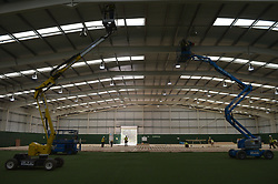 Workers during the construction of a field hospital, which will hold up to 340 beds for coronavirus patients, at Llandarcy Academy of Sport, Neath, as the health services in the Swansea Bay area prepare their response to the coronavirus outbreak.