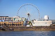 55 meters high ferris wheel of the carnyman Kipp in the Rheinau harbor in front of the Chocolate Museum, Cologne, Germany.<br /> <br /> 55 Meter hohes Riesenrad des Schausteller Kipp im Rheinauhafen vor dem Schokoladenmuseum, Koeln, Deutschland.