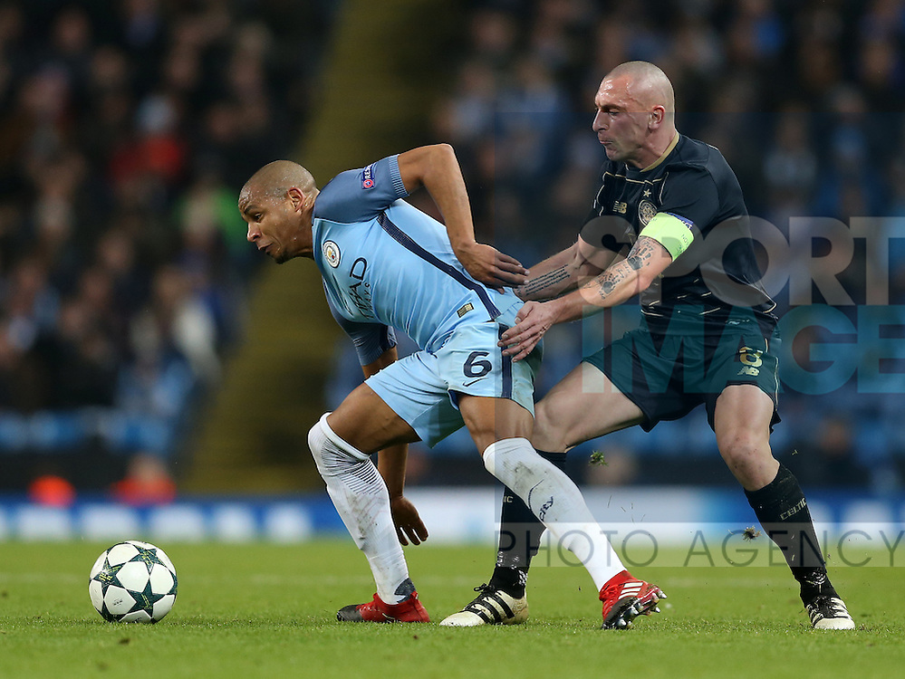 Fernando of Manchester City tussles with Scott Brown of Celtic during the Champions League Group C match at the Etihad Stadium, Manchester. Picture date: December 6th, 2016. Pic Simon Bellis/Sportimage