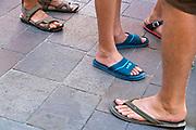 summer tourists wearing flip flops