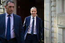 © Licensed to London News Pictures. 18/10/2019. London, UK. Foreign Secretary Dominic Raab leaves media studios this morning. Yesterday, British Prime Minister Boris Johnson agreed a Brexit deal with the EU. Photo credit : Tom Nicholson/LNP