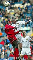 Fotball: Liverpool Emile Heskey wins a header against Leeds Dominic Matteo during the Premiership match at Elland Road, Leeds. Liverpool won 4-0.<br /><br />Sunday February 3rd 2002<br /><br />Foto:  David Rawcliffe/Digitalsport<br /><br />Any problems call David Rawcliffe - 07973 142020 - 07092 261 201 - david@propaganda-photo.com