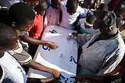 Children and young men place bets as they try to guess which face a die will land on during annual Oguaa Fetu Afahye Festival in Cape Coast, Ghana on Saturday September 6, 2008...