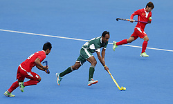 Pakistan's Muhammad Umar Bhutta and China's Wenhui E (left) during the Men's World Hockey League Semi Final, 7th/8th place match at Lee Valley Hockey Centre, London.