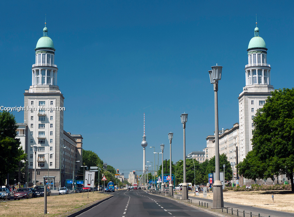 View along Karl Marx Allee towards Frankfurter Tor and TV Tower at Alexanderplatz in Berlin Germany