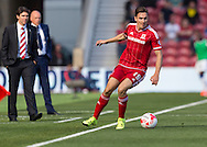 Middlesbrough FC midfielder Stewart Downing in action watched by both managers during the Sky Bet Championship match between Middlesbrough and Leeds United at the Riverside Stadium, Middlesbrough, England on 27 September 2015. Photo by George Ledger.