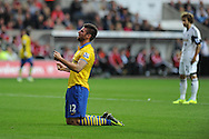 Arsenal's Olivier Giroud © reacts after he misses a goal chance . Barclays Premier league, Swansea city v Arsenal at the Liberty Stadium in Swansea on Saturday 28th Sept 2013.  pic by Andrew Orchard, Andrew Orchard sports photography.
