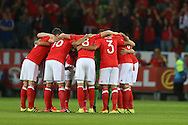 Wales players huddle together ahead of k/o. Wales v Moldova , FIFA World Cup qualifier at the Cardiff city Stadium in Cardiff on Monday 5th Sept 2016. pic by Andrew Orchard, Andrew Orchard sports photography
