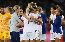 USA's Abby Dahlkemper (left) and Tobin Heath embrace after the game