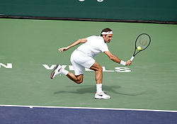 March 10, 2019 - Indian Wells, CA, U.S. - INDIAN WELLS, CA - MARCH 10: Roger Federer (SUI) hits a backhand during the second round of the BNP Paribas Open on March 10, 2019, at the Indian Wells Tennis Gardens in Indian Wells, CA. (Photo by Adam Davis/Icon Sportswire) (Credit Image: © Adam Davis/Icon SMI via ZUMA Press)