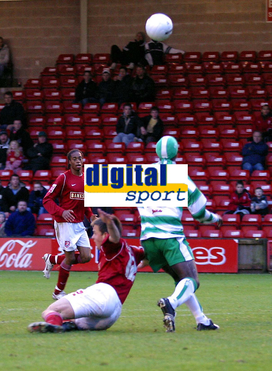 Photo: Dave Linney.<br />Matty Fryatt ( Walsall ) is brought down by   Efe Sodje( Yeovil ) and who gave away a penalty.Walsall v Yeovil Town. The FA Cup. 03/12/2005.