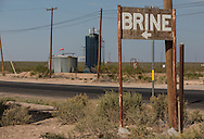 Sign for a place selling water with brine in it. Brine, a salt solution  in it is being used by the hydraulic fracturing industry in the Permian Basin in West Texas, where water is scarce.