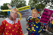 Anti Brexit protesters dressed up as a clown version of Prime Minister Boris Johnson outside the Downing Street in Westminster as it is announced that Boris Johnson has had his request to suspend Parliament approved by the Queen on 28th August 2019 in London, England, United Kingdom. The announcement of a suspension of Parliament for approximately five weeks ahead of Brexit has enraged Remain supporters who suggest this is a sinister plan to stop the debate concerning a potential No Deal.