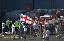 Fans await the arrival of the England team at Birmingham Airport as the England squad return to the UK.