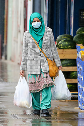 © Licensed to London News Pictures. 13/05/2021. London, UK. An Asian woman wearing a face covering in north London. It has been reported that government officials are discussing ending coronavirus face covering rules and only making masks mandatory on public transport by the end of June. The next stage of the Covid-19 lockdown easing takes place from Monday 17 May, allowing people to hug and return to mixing indoors in pubs and restaurants. Photo credit: Dinendra Haria/LNP