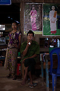 A man smokes a cigar in a street restaurant near Dawei City, Burma.<br />