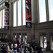 Fans arrive at Yankee Stadium for the New York Yankees V Detroit Tigers Baseball game at Yankee Stadium, The Bronx, New York. 28th April 2012. Photo Tim Clayton