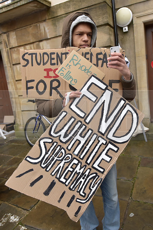 © Licensed to London News Pictures. 09/03/2016 outside Oriel College. Speeches and songs. Rhodes must fall demonstration and march through Oxford. Protest outside Oriel College followed by a march through the streets of Oxford. Photo credit : MARK HEMSWORTH/LNP