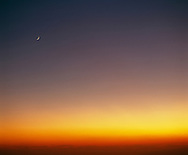 Crescent moon over Los Angeles Basin at sunset.