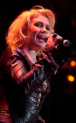 Kim Wilde steps out of the her TV Gardening clothes and Back on Stage to Tour with<br /><br />Steve Starnge (Visage)<br />Claire Grogan (Altered Images)<br />The Belle Stars<br />Dollar<br />The Human League<br />Play on the Here and Now  Christmas Party Tour at Sheffields Hallam FM Arena Friday 13th December 2002<br /><br />[#Beginning of Shooting Data Section]<br />Nikon D1 <br />2002/12/13 22:23:09.4<br />JPEG (8-bit) Fine<br />Image Size:  2000 x 1312<br />Color<br />Lens: 80-200mm f/2.8-2.8<br />Focal Length: 100mm<br />Exposure Mode: Manual<br />Metering Mode: Spot<br />1/200 sec - f/2.8<br />Exposure Comp.: 0 EV<br />Sensitivity: ISO 800<br />White Balance: Auto<br />AF Mode: AF-S<br />Tone Comp: Normal<br />Flash Sync Mode: Not Attached<br />Color Mode: <br />Hue Adjustment: <br />Sharpening: Normal<br />Noise Reduction: <br />Image Comment: <br />[#End of Shooting Data Section]
