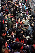 Passengers crowd Shanghai South train station in Shanghai, China, on January 7, 2009. Photo by Lucas Schifres/Pictobank
