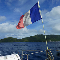 France, Martinique; Anse Mitan. French flag on sailing boat in Martinique.