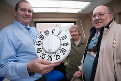 Resource Officer from in the mobile unit holding up a tactile kitchen timer,