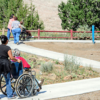 Guests wind through new concrete walkways at the Navajo Nation Zoo in Window Rock Thursday.