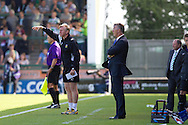 Yeovil Town assistant manager Terry Skiverton (far left) and manager of Reading Nigel Adkins (right) during the Skybet championship match, Yeovil Town v Reading at Huish Park in Yeovil on Saturday 31st August 2013. <br /> Picture by Sophie Elbourn, Andrew Orchard sports photography,
