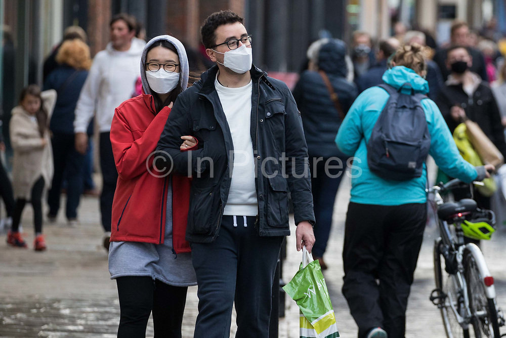 Shoppers wear face coverings to help prevent the spread of the coronavirus on 10 October 2020 in Windsor, United Kingdom. The Royal Borough of Windsor and Maidenhead has seen a significant rise in the COVID-19 infection rate over the past week, giving it the second-highest infection rate in South-East England outside London.