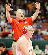 Wadsworth head coach John Gramuglia, back, lets everyone know the score is tied 5-5 after Orgegon Clay's Garrett Gray (not pictured) mistakenly celebrated after the sixth period thinking he had defeated Nick Tavanello of Wadsworth. DAVID RICHARD / GAZETTE