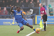AFC Wimbledon defender Deji Oshilaja (4) stretching to keep the ball in play during the EFL Sky Bet League 1 match between AFC Wimbledon and Blackpool at the Cherry Red Records Stadium, Kingston, England on 20 January 2018. Photo by Matthew Redman.