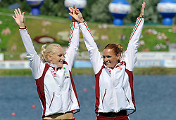 KATALIN KOVACS & NATASA JANICS (BOTH HUNGARY) CELEBRATES THEIR GOLD MEDALS IN WOMEN'S K2 200 METERS FINAL A RACE DURING 2010 ICF KAYAK SPRINT WORLD CHAMPIONSHIPS ON MALTA LAKE IN POZNAN, POLAND...POLAND , POZNAN , AUGUST 22, 2010..( PHOTO BY ADAM NURKIEWICZ / MEDIASPORT ).
