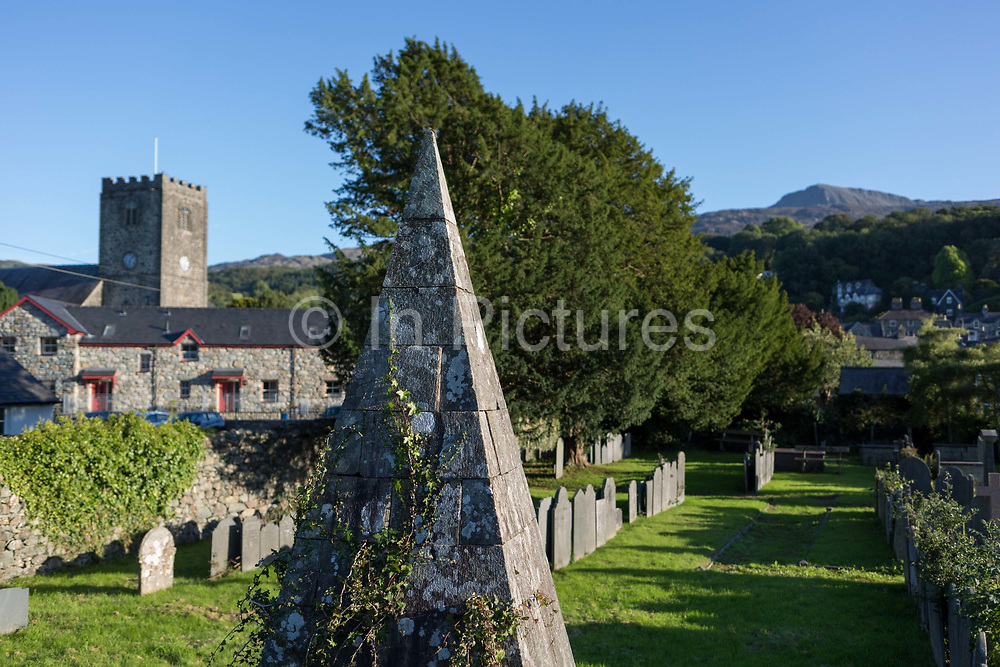 A pyramid memorial in the cemetery of St. Marys Church and in the distance, the 2,928ft mountain Cader Idris, on 12th September 2018, in Dolgellau, Gwynedd, Wales.