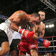 Ali Tareh (red shorts) fights Oscar Gonzalez during a Telemundo boxing match at the A La Carte Pavilion  on Friday, August 1, 2014 in Tampa, Florida. (AP Photo/Alex Menendez)