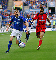 Photo: Kevin Poolman.<br />Leicester City v Colchester United. Coca Cola Championship. 23/09/2006. Stephen Hughes gets away from Colchester's Karl Duguid.