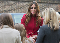 © Licensed to London News Pictures. 07/11/2013.  The Duke and Duchess of Cambridge met members of the Poppy Girls today at Kensington Palace today as the Royal British Legion aimed to collect a million pounds in one day.  The Royal couple then popped onto a Poppy bus and met with former and serving soldiers at High Street Kensington.      Photo credit: Alison Baskerville/LNP