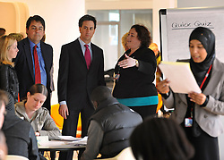 © Licensed to London News Pictures. 16/04/2012. London, UK . STEPHEN TWIGG (blue shirt) and ED MILIBAND talk with Senior Trainer SARAH GONZAGA. Ed Miliband MP, Leader of the Labour Party UK, visits The Skills Place in Westfield Stratford today, 16th April 2012, on a visit to highlight youth unemployment issues. Photo credit : Stephen Simpson/LNP