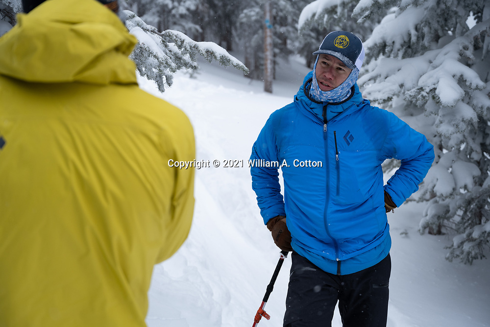 Diamond Peaks Ski Patrol director Owen Richard talks with skiers while on a duty day in the Montgomery Pass area, Feb. 6, 2021.