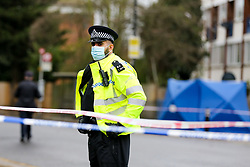 © Licensed to London News Pictures. 20/01/2021. London, UK. Police officer guards a murder scene on West Green Road in Haringey, north London as police launch a murder investigation following the fatal stabbing of a teenage boy in Haringey. Police were called at 21:10hrs on Tuesday 19 January 2021 to the West Green Road junction with Willow Walk, following reports of a stabbing. Officers attended with the London Ambulance Service and found a male, aged 17, suffering from a stab injury. The victim was pronounced dead at 04:25hrs on Wednesday 20 January. . Photo credit: Dinendra Haria/LNP