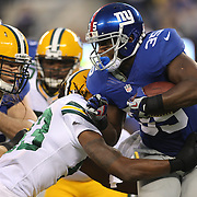 Andre Brown, New York Giants, is tackled by the Packers defense during the New York Giants Vs Green Bay Packers, NFL American Football match at MetLife Stadium, East Rutherford, New Jersey, USA. 17th November 2013. Photo Tim Clayton