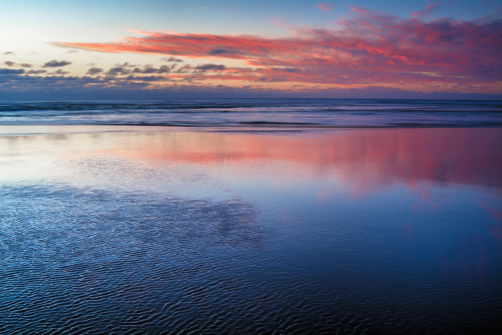 A vividly memorable and bitterly cold sunset on Oregon's Cannon Beach.