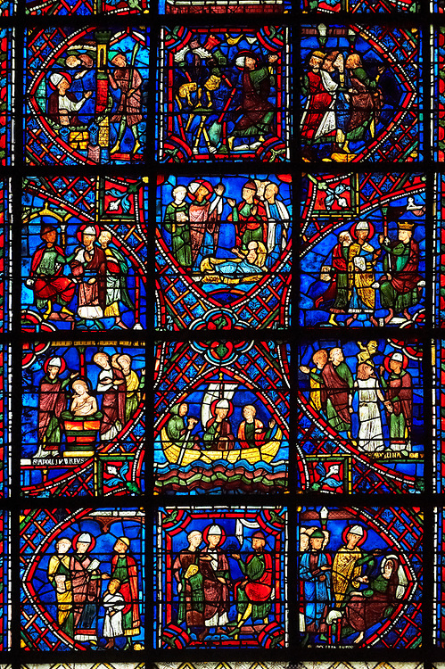 Medieval stained glass Window of the Gothic Cathedral of Chartres, France - dedicated to The life of St Apollinarie. Stained glass panels from bottom left - possible the Healing of the blind son of the judge Thaurus, centre - Apollinaris meeting the Tribune of Ravenna, left - Apollinaris heals the Tribune's wife. Second row from bottom - left - Baptism of the Tribune of Ravenna and his household, centre - Apollinaris going into (or returning from) exile, left - Apollinaris cures the maid possessed by 'an unclean spirit', Third row - left - Apollinaris enters the house of Rufus Patricius, Duke of Ravenna, centre - Through prayer, Apollinaris restores Rufus's daughter to life, right - The Provost orders Apollinaris to sacrifice to the pagan gods. Top row - left - possibly, Apollinaris is visited by an angel In prison , centre - In response to Apollinaris's prayers, a temple of Jupiter collapses, right - The Provost and other witnesses to the destruction of the temple. A UNESCO World Heritage Site.. .<br /> <br /> Visit our MEDIEVAL ART PHOTO COLLECTIONS for more   photos  to download or buy as prints https://funkystock.photoshelter.com/gallery-collection/Medieval-Middle-Ages-Art-Artefacts-Antiquities-Pictures-Images-of/C0000YpKXiAHnG2k