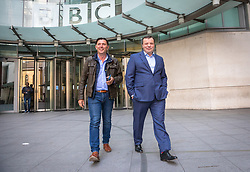 © Licensed to London News Pictures. 23/04/2017. London, UK. Millionaire UKIP donor ARRON BANKS (R) leaves Broadcasting House after appearing on Sunday Politics. Banks intends to stand for election as an MP in Clacton, the seat currently held by former UKIP MP and rival Douglas Carswell who will not stand for reelection in the 8 June General Election. Photo credit: Rob Pinney/LNP